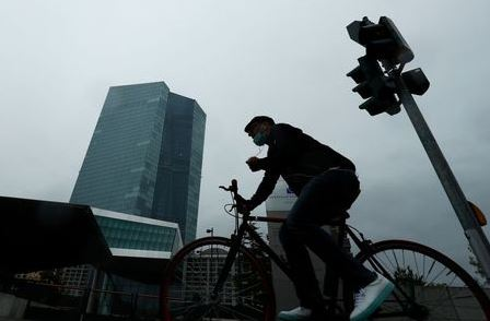 A man cycles towards the European Central Bank (ECB) headquarters in Frankfurt, Germany, July 8, 2020. REUTERS/Ralph Orlowski