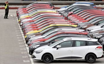 Renault cars produced in Turkey and awaiting export throughout Europe, are checked by a worker in the port of Koper October 14, 2013. Automotive industry association ACEA said October 16, 2013, that new car registrations in Europe climbed 5.5 percent to 1.19 million vehicles in September, only the third month a gain was recorded in the past two years. But within the European Union, the level of demand was the second lowest on record for the month of September since it began tabulating results for the 27 member states in 2003. Picture taken October 14. REUTERS/Srdjan Zivulovic (SLOVENIA - Tags: TRANSPORT BUSINESS)