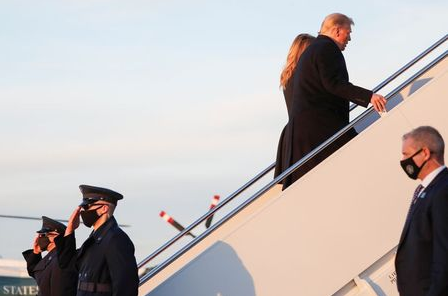 U.S. President Donald Trump and first lady Melania Trump board Air Force One at Joint Base Andrews in Maryland, U.S., December 23, 2020. REUTERS/Tom Brenner
