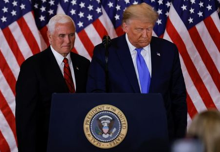U.S. President Donald Trump and Vice President Mike Pence stand while making remarks about early results from the 2020 U.S. presidential election in the East Room of the White House in Washington, U.S., November 4, 2020. REUTERS/Carlos Barria
