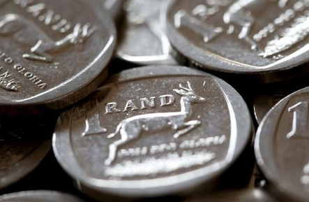 South African Rand coins are seen in this photo illustration taken September 9, 2015. South Africa's rand recovered some ground on Monday after falling 4 percent on Friday due to a row involving the finance minister, but government bonds fell. REUTERS/Mike Hutchings