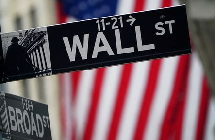 A Wall Street sign is pictured outside the New York Stock Exchange in the Manhattan borough of New York City, New York, U.S., October 2, 2020. REUTERS/Carlo Allegri
