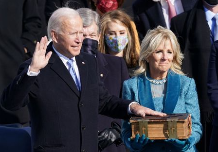 Joe Biden is sworn in as the 46th President of the United States as his wife Jill Biden holds a bible on the West Front of the U.S. Capitol in Washington, U.S., January 20, 2021. REUTERS/Kevin Lamarque TPX IMAGES OF THE DAY