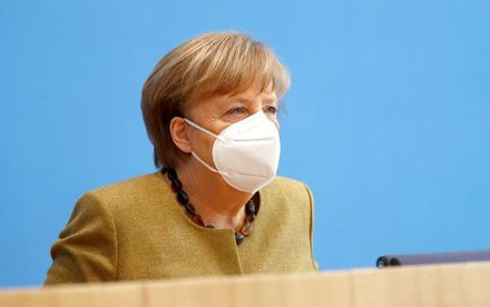 German Chancellor Angela Merkel leaves following a news conference about the current situation of the spread of the coronavirus disease (COVID-19), in Berlin, Germany, January 21, 2021. REUTERS/Fabrizio Bensch/Pool