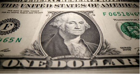 A U.S. Dollar banknote is seen in this illustration taken May 26, 2020. REUTERS/Dado Ruvic/Illustration