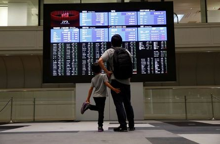 Visitors look at a stock quotation board at Tokyo Stock Exchange in Tokyo Japan, October 11, 2018. REUTERS/Issei Kato