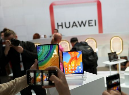 People take pictures of Huawei Mate Xs foldable smartphone and a Huawei MatePad Pro during Huawei product launch event in Barcelona, Spain February 24, 2020. REUTERS/Nacho Doce