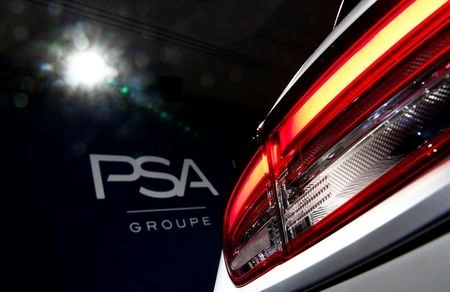 A PSA Group logo is seen behind a car displayed during French carmaker's news conference as they announce the company's 2018 results at their headquarters in Rueil-Malmaison, near Paris, France, February 26, 2019. REUTERS/Christian Hartmann