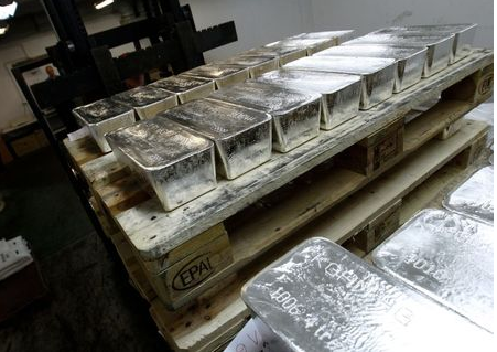 Bars of silver are placed on wooden pallets at the KGHM copper and precious metals smelter processing plant in Glogow May 10, 2013. Silver prices swung wildly in the wake of extreme losses seen in gold last month, but while investors fled bullion-backed funds in droves, holdings in the less glamorous precious metal are remarkably robust, for now. REUTERS/Peter Andrews (POLAND - Tags: BUSINESS COMMODITIES INDUSTRIAL)
