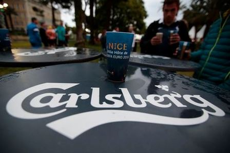 A fan holds Carlsberg beer in the fan zone before watching the France v Albania EURO 2016 Group A soccer match,in Nice, France, June 15, 2016. REUTERS/Eric Gaillard