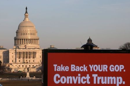 Trucks advertising in support of convicting former U.S President Donald Trump in his upcoming second impeachment trial are seen parked on the National Mall with the U.S. Capitol Building visible behind them in Washington, U.S., February 8, 2021. REUTERS/Leah Millis