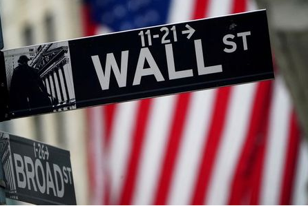 FILE PHOTO: A Wall Street sign outside the New York Stock Exchange in New York City, New York, U.S., October 2, 2020. REUTERS/Carlo Allegri
