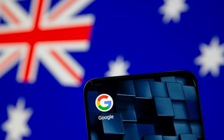 Smartphone with google app icon is seen in front of the displayed Australian flag in this illustration taken, January 22, 2021. REUTERS/Dado Ruvic/Illustration