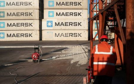 FILE PHOTO: A worker is seen next to Maersk shipping containers at a logistics center near Tianjin port, in Tianjin, China December 12, 2019. Picture taken December 12, 2019. REUTERS/Yilei Sun
