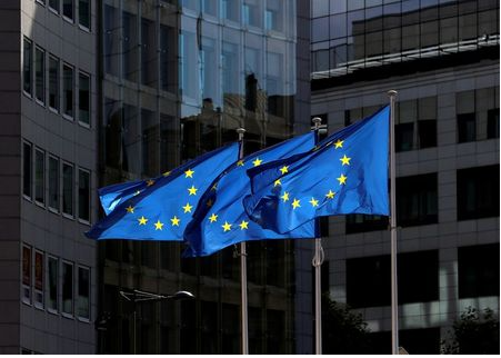 European Union flags flutter outside the European Commission headquarters in Brussels, Belgium August 21, 2020. REUTERS/Yves Herman