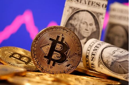 A representation of virtual currency Bitcoin and U.S. One Dollar banknotes are seen in front of a stock graph in this illustration taken January 8, 2021. REUTERS/Dado Ruvic