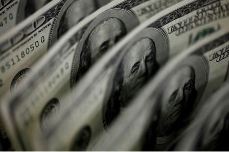 FILE PHOTO: A picture illustration shows U.S. 100 dollar bank notes taken in Tokyo August 2, 2011. REUTERS/Yuriko Nakao/File Photo/File Photo