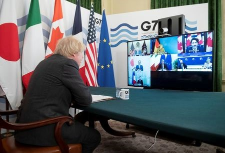 Britains Prime Minister Boris Johnson hosts the Online G7 Summit in the Cabinet Room at Downing Street in London, Britain February 19, 2021. Geoff Pugh/Pool via REUTERS