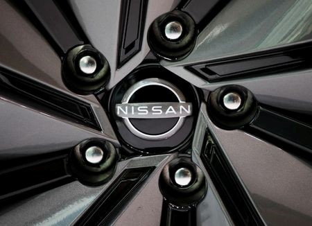 The brand logo of Nissan Motor Corp. is seen on a tyre wheel of the company's car at their showroom in Tokyo, Japan November 11, 2020. REUTERS/Issei Kato