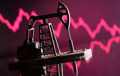 A 3D printed oil pump jack is seen in front of displayed stock graph in this illustration picture, April 14, 2020. REUTERS/Dado Ruvic/Illustration