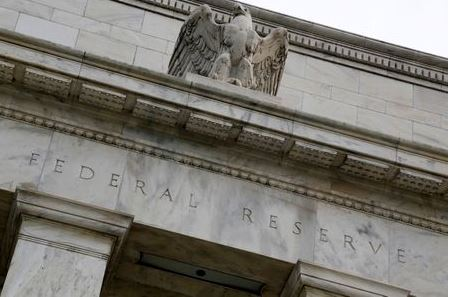 An eagle tops the U.S. Federal Reserve building's facade in Washington, July 31, 2013. The U.S. Federal Reserve likely will decide at the end of a policy meeting on Wednesday to continue buying bonds at an $85 billion monthly pace, but it could alter an accompanying statement to spell out the possibility of scaling back purchases later this year. REUTERS/Jonathan Ernst (UNITED STATES - Tags: POLITICS BUSINESS)