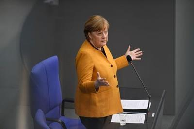German Chancellor Angela Merkel gestures during a plenum session of the lower house of parliament, the Bundestag, in Berlin, Germany, March 24, 2021. REUTERS/Annegret Hilse