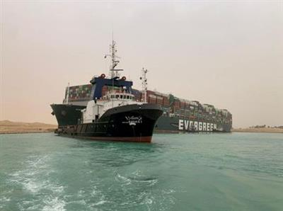 FILE PHOTO: A container ship which was hit by strong wind and ran aground is pictured in Suez Canal, Egypt March 24, 2021. SUEZ CANAL AUTHORITY/Handout via REUTERS/File Photo