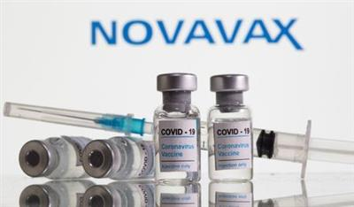"Vials labelled ""COVID-19 Coronavirus Vaccine"" and sryinge are seen in front of displayed Novavax logo in this illustration taken, February 9, 2021. REUTERS/Dado Ruvic/Illustration"
