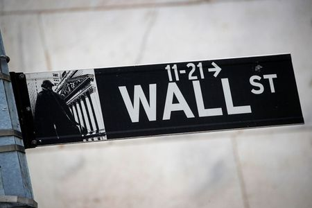 The Wall St. sign is seen outside The New York Stock Exchange (NYSE) in New York, U.S., March 1, 2021. REUTERS/Brendan McDermid