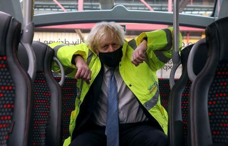 Britain's Prime Minister Boris Johnson sits on a bus during a visit to the National Express depot in Coventry, Britain March 15, 2021. Steve Parsons/Pool via REUTERS TPX IMAGES OF THE DAY