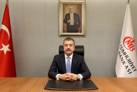 FILE PHOTO: Turkey's new Central Bank Governor Sahap Kavcioglu sits at his office in Ankara, Turkey March 21, 2021. Turkish Central Bank/Handout via REUTERS ATTENTION EDITORS - THIS PICTURE WAS PROVIDED BY A THIRD PARTY. NO RESALES. NO ARCHIVE./File Photo