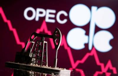 FILE PHOTO: A 3D printed oil pump jack is seen in front of displayed stock graph and Opec logo in this illustration picture, April 14, 2020. REUTERS/Dado Ruvic/Illustration/File Photo