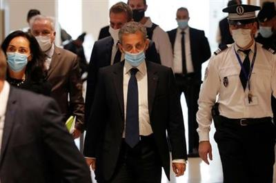 Former French President Nicolas Sarkozy, wearing a protective face mask, arrives for the verdict in his trial on charges of corruption and influence peddling, at Paris courthouse, France, March 1, 2021. REUTERS/Gonzalo Fuentes