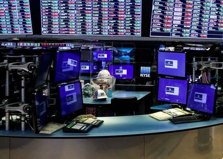 Dividers are seen inside a trading post on the trading floor as preparations are made for the return to trading at the New York Stock Exchange (NYSE) in New York, U.S., May 22, 2020. REUTERS/Brendan McDermid