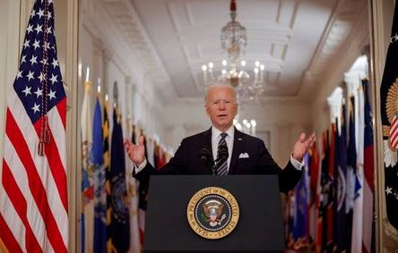 U.S. President Joe Biden delivers his first prime time address as president, marking the one-year anniversary of widespread shutdowns to combat the coronavirus disease (COVID-19) pandemic and speaking about the impact of the pandemic during an address from the East Room of the White House in Washington, U.S., March 11, 2021. REUTERS/Tom Brenner TPX IMAGES OF THE DAY