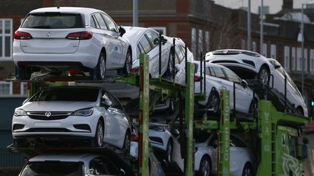 Vauxhall cars are transported on a lorry in Luton, Britain March 6, 2017. REUTERS/Neil Hall