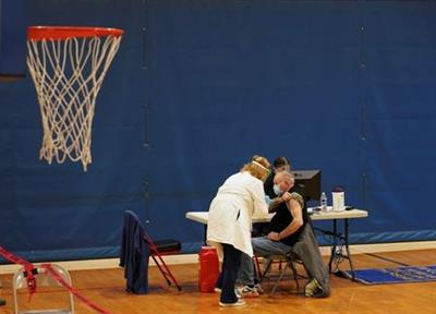 A basketball net hangs at a recreation center as patients receive their boost dose at a coronavirus disease (COVID-19) community vaccination event, as the vaccination rate in West Virginia ranks among highest in world, in Martinsburg, U.S. February 25, 2021. REUTERS/Kevin Lamarque
