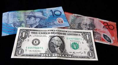 FILE PHOTO: A U.S. dollar note (bottom) is pictured alongside an Australian 10 dollar (L) and 20 dollar bill in this picture illustration taken in Washington, October 14, 2010. REUTERS/Jason Reed/File Photo