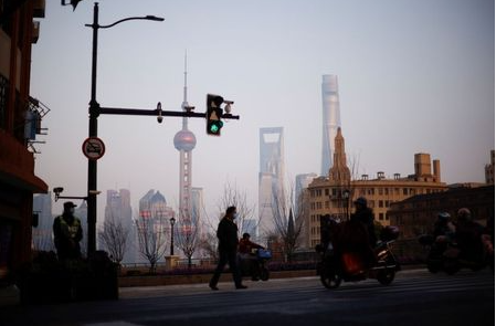 People walk on a street, in front of Lujiazui financial district of Pudong, in Shanghai, China March 4, 2021. Picture taken March 4, 2021. REUTERS/Aly Song