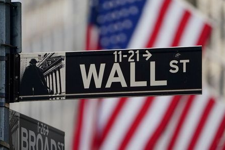 FILE PHOTO: The Wall Street sign is pictured at the New York Stock exchange (NYSE) in the Manhattan borough of New York City, New York, U.S., March 9, 2020. REUTERS/Carlo Allegri