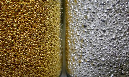 FILE PHOTO: Granules of 99.99 percent pure gold and silver are seen in glass jars at the Krastsvetmet non-ferrous metals plant, one of the world's largest producers in the precious metals industry, in the Siberian city of Krasnoyarsk, Russia November 22, 2018. Picture taken November 22, 2018. REUTERS/Ilya Naymushin/File Photo