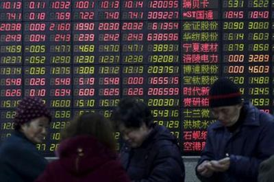 FILE PHOTO: Investors stand in front of an electronic board showing stock information on the first trading day after the week-long Lunar New Year holiday at a brokerage house in Shanghai, China, February 15, 2016. China stocks opened more than 2 percent lower on Monday, as they played catch-up with bearish global markets after the week-long Lunar New Year holiday. REUTERS/Aly Song/File Photo