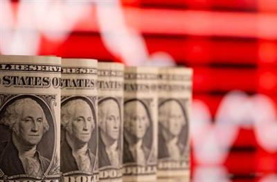 FILE PHOTO: U.S. one dollar banknotes are seen in front of displayed stock graph in this illustration taken February 8, 2021. REUTERS/Dado Ruvic/Illustration/File Photo