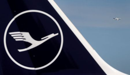 A Lufthansa plane takes off behind a grounded jet at the airport as the spread of coronavirus disease (COVID-19) continues in Frankfurt, Germany, June 2, 2020. REUTERS/Kai Pfaffenbach/File Photo
