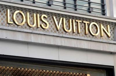 A Louis Vuitton logo is seen outside a store on the Champs-Elysees in Paris, France, September 18, 2020. REUTERS/Charles Platiau