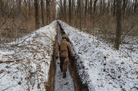 FILE PHOTO: A Ukrainian service member walks along fighting positions on the contact line with Russian-backed separatist rebels near the town of Avdiivka in Donetsk Region, Ukraine February 13, 2021. REUTERS/Oleksandr Klymenko
