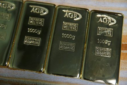 Gold bars weighing 1kg are seen at AGR (African Gold Refinery) in Entebbe, Uganda, October 4, 2018. Picture taken October 4, 2018. To match Insight AFRICA-GOLD/REFINERIES REUTERS/Baz Ratner