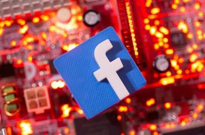 FILE PHOTO: A 3D printed Facebook logo is placed on a computer motherboard in this illustration taken January 21, 2021. REUTERS/Dado Ruvic/Illustration/File Photo