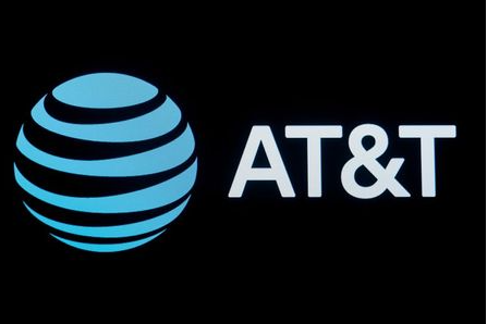 FILE PHOTO: The company logo for AT&T is displayed on a screen on the floor at the New York Stock Exchange (NYSE) in New York, U.S., September 18, 2019. REUTERS/Brendan McDermid/File Photo