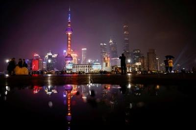 A general view of the financial district of Pudong during Earth Hour, in Shanghai, China March 27, 2021. REUTERS/Aly Song REFILE - CORRECTING TIMING